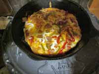 Pizza in a cast iron skillet cooked inside the stove yummy!